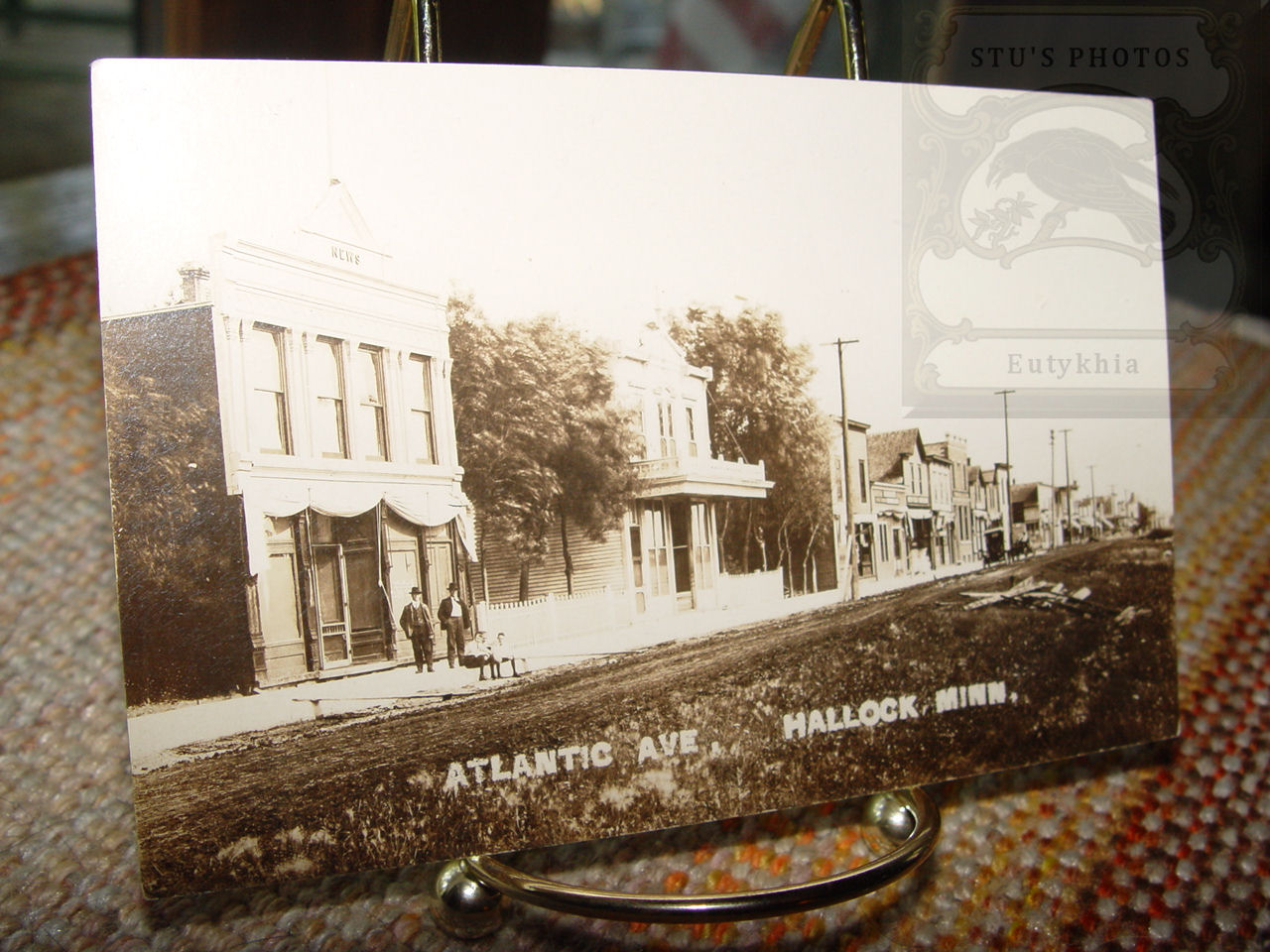 Early RPPC of                                         Atlantic Ave in Hallock MN ~                                         News Building and Store Fronts                                         1910