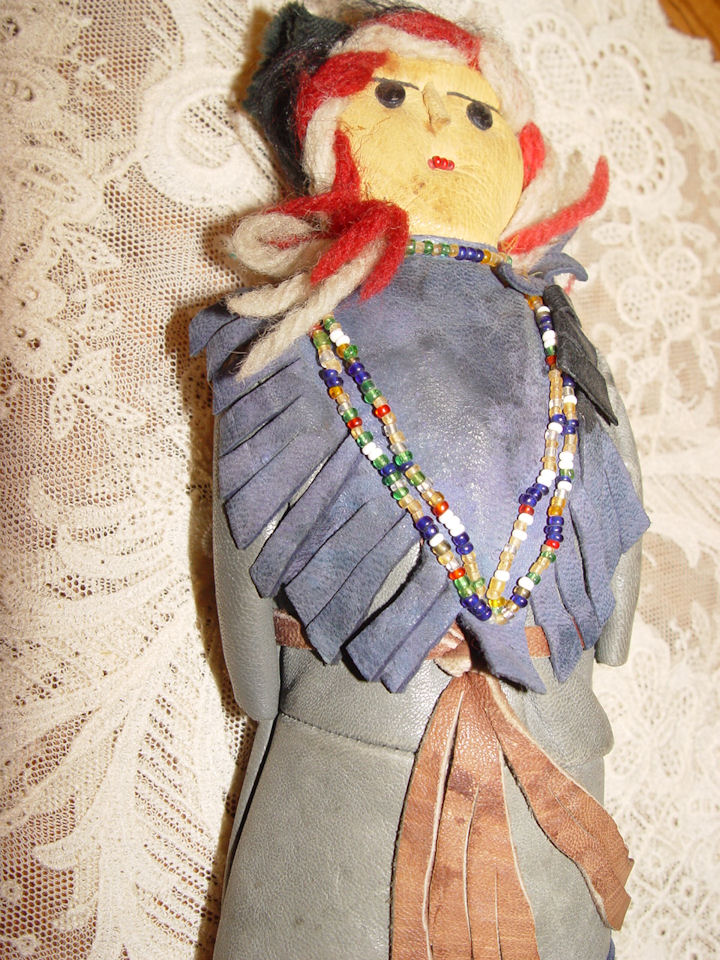 Vintage Native                                         American Indian child's doll all                                         leather handmade, beaded, and                                         yarn hair c. 1940's / 50's