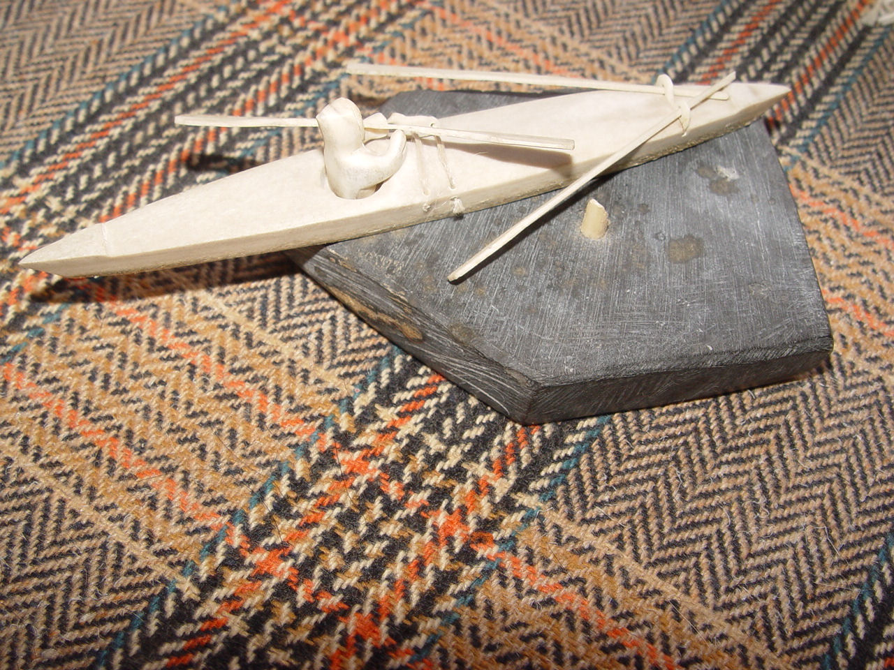 Fine Inuit                                         Alaska Carved Native Eskimo In                                         bone Canoe w/ Spears, Paddles,                                         Stone Base